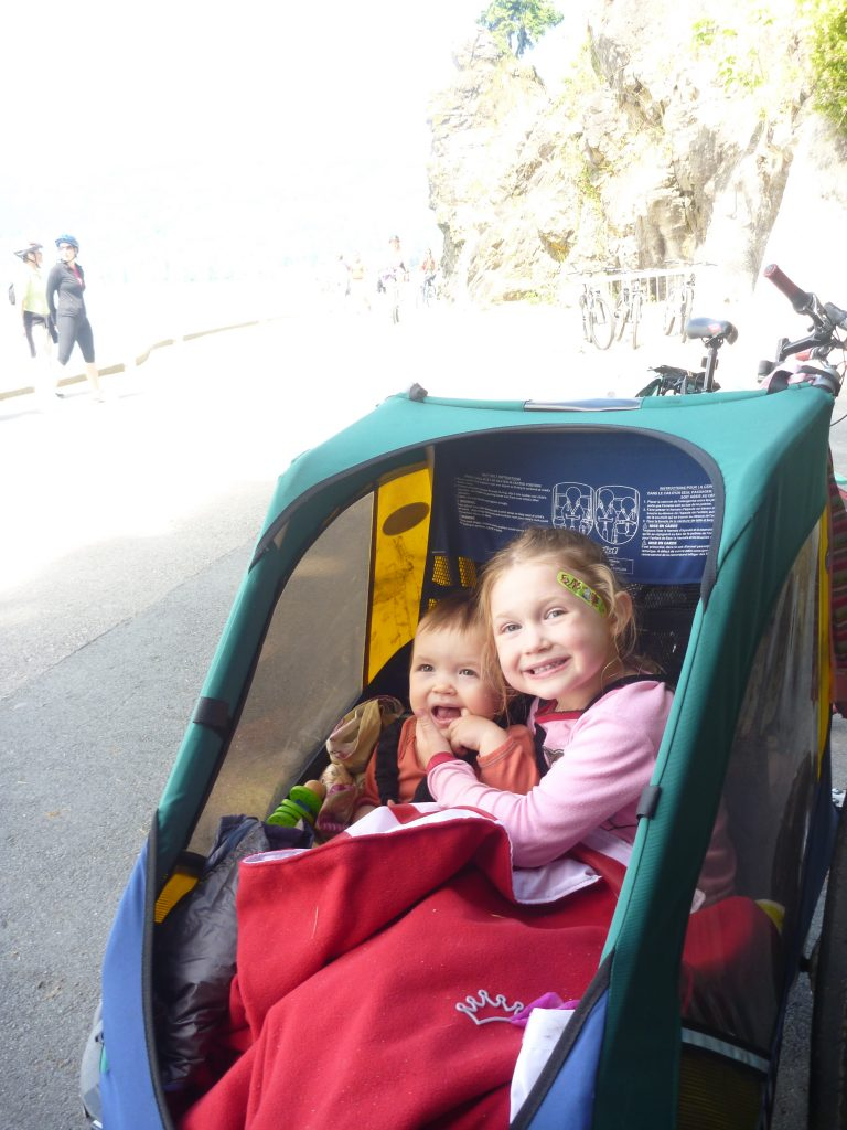 kids in bike trailer